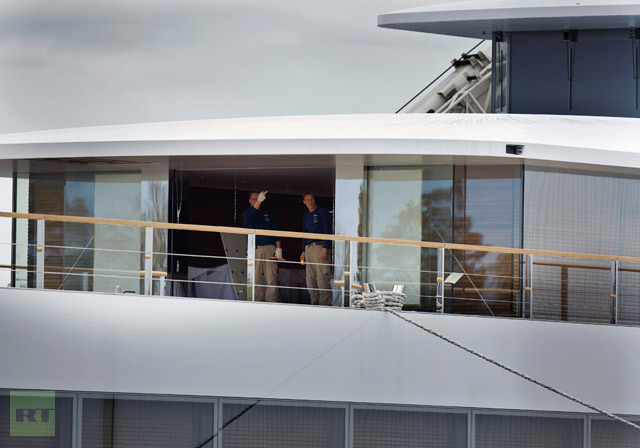 Two men stand on the yacht Apple founder Steve Jobs designed during the last days of his life at a shipyard in Aalsmeer