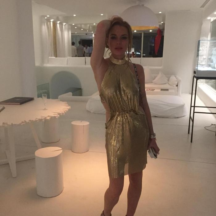 IN VRETTOS VRETTAKOS  METAL MESH GOLD HAUTE COUTURE MINI DRESS.CRYSTAL GOLDEN SHADOW SWAROVSKI DETAILS GLOW THE MINI GLAMOUR DRESS AND BLOW AWAY HER FANS....