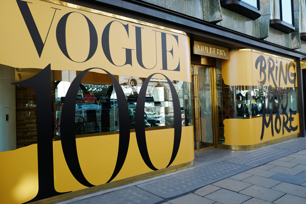 Major retail brands have created window displays across the UK to celebrate the centenary of British Vogue.