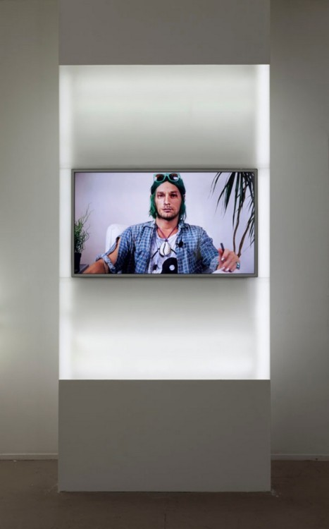 Josh Kline Forever 27 (Kurt) 2013 Installation view, 47 Canal, New York  HD video, sound, color, 14:39 min  Light-box display: Plexiglass, LED lights, MDF, plywood, HD television, media player, SD card Image courtesy of the artist and 47 Canal, New York. Photo: Joerg Lohse.