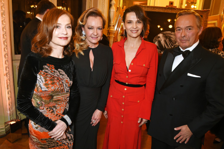 PARIS, FRANCE - JANUARY 21:  (L to R) Isabelle Huppert, Caroline Scheufele, Artistic Director and Co-President of Chopard, Juliette Binoche and Karl-Friedrich Scheufele, Co-President of Chopard, attend as Chopard presents The Garden Of Kalahari collection at Theatre du Chatalet on January 21, 2017 in Paris, France.  (Photo by David M. Benett/Dave Benett/Getty Images for Chopard ) *** Local Caption *** Isabelle Huppert;Caroline Scheufele;Juliette Binoche;Karl-Friedrich Scheufele