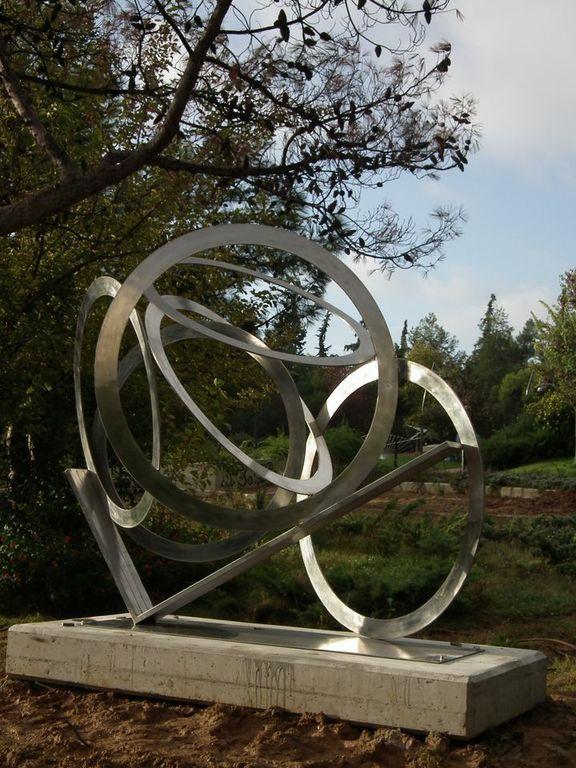 """""""Ολυμπιακοί Κύκλοι""""-2001, Ανοξείδωτος Χάλυβας, Διαστάσεις: Ύψος 193εκ.-Πλάτος 226 εκ."""