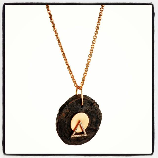 If you really love me...This wooden pendant is embellished with a rose gold triangle, symbolizing prosperity! By Zeus+Dione...