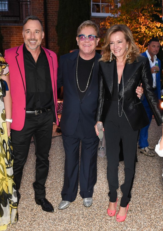 David Furnish, Elton John & Caroline Scheufele all wearing Chopard...