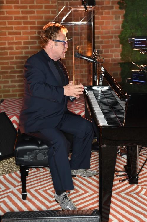 Elton John performing...