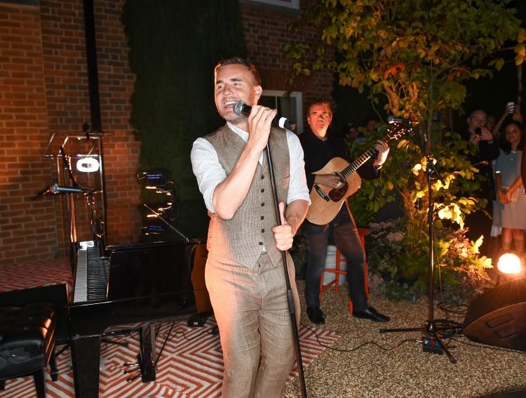 Gary Barlow performing...