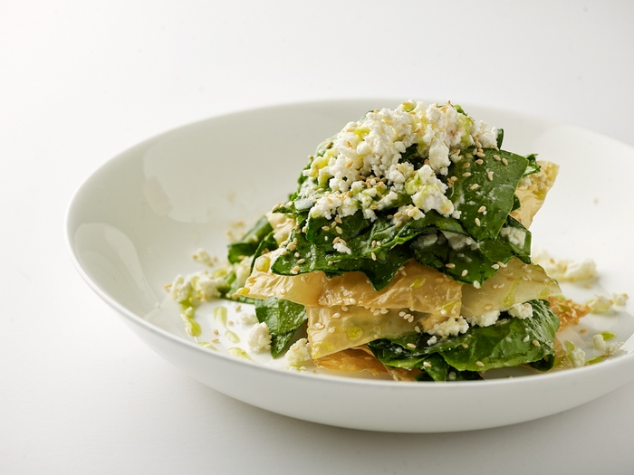 Spinach pie with honey vinaigrette, sesame & drizzles of dill syrup
